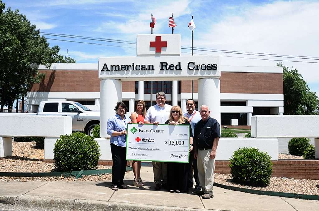 (From left)  Jill Robertson with Farm Credit of Western Arkansas, Lauren Burns with Delta Agricultural Credit Association,  Cole Plafcan with AgHeritage Farm Credit Services and (far right) Randy Kingston with Farm Credit Midsouth present Farm Credit's donation to Pam Knapp-Carver, executive director for the Northeast Arkansas chapter of the American Red Cross, and Steve Biernacki, regional philanthropy officer.